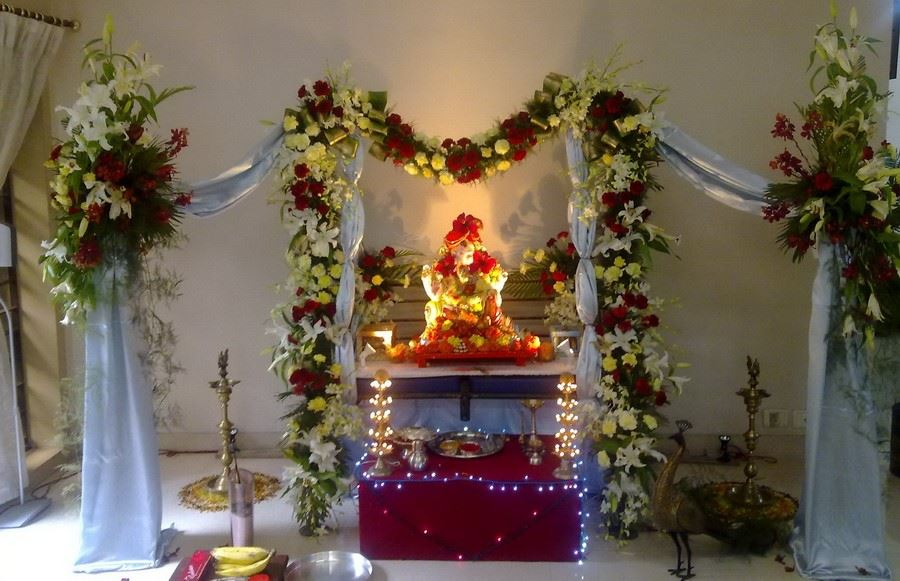 Pooja decoration with fresh flower ganpati pooja durga pooja home pooja decoration for 111 3 5 9 days exclusive pooja decoration is decorated with oriental lily carnation and orchid junglespirit Image collections